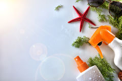 Two sunscreen spray with starfish and sunglasses top view Royalty Free Stock Images