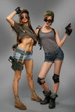Two super military sexy girl up arms Royalty Free Stock Photo