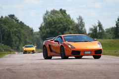 Two supercars on a racetrack Royalty Free Stock Image