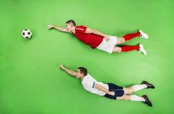 Two superhero football players Stock Photos