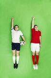 Two superhero football players Stock Images