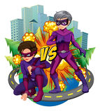 Two superheroes in the city Royalty Free Stock Photos