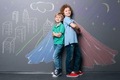 Two superheroes defend the city stock images
