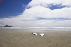 Two surfboards lie on the beach at Incinerator Rock. Pacific Rim National Park Royalty Free Stock Photo