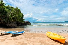 Two surfboards and a yellow kayak for active sports. In the water Royalty Free Stock Images