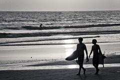 Two Surfers on Beach Stock Images