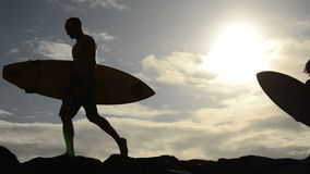 Two Surfers. At Sunset In Hawaii stock video footage