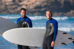 Two surfers talking on the beach Stock Photo
