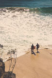 Two surfers. Walking into the water ready for some wave action Royalty Free Stock Images