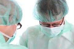 Two surgeon at work Stock Image