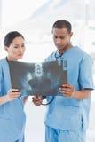 Two surgeons examining xray Stock Photos