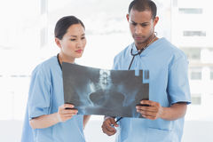 Two surgeons examining xray Royalty Free Stock Photos