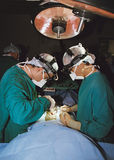 Two surgeons operating. Two surgeons in operating room in surgery- vertical orientation Royalty Free Stock Image