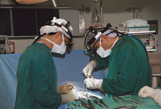 Two surgeons operating. In operating room, horizontal orientation Royalty Free Stock Photography