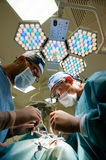 Two surgeons in operating room making plastic surgery. Royalty Free Stock Photo