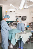 Two surgeons performing operation Stock Photography