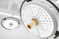 Two surgical lamps in operation room Royalty Free Stock Photo