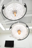Two surgical lamps in operation room Royalty Free Stock Photos