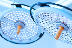 Two surgical lamps take with blue filter Royalty Free Stock Image
