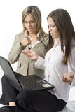Two surprised manager women. Two surprised young manager ladies with notebook on white background Stock Images