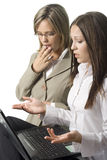 Two surprised manager women. Two surprised young manager ladies with notebook on white background Stock Photography
