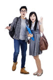 Two surprised students standing in studio Royalty Free Stock Images