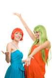 Two surprised young women with color hair Stock Image