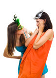 Two surprised young women wearing mask at masquera Royalty Free Stock Image