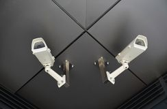 Two surveillance cameras Stock Images