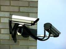 Two surveillance cameras. On brick facade Stock Images