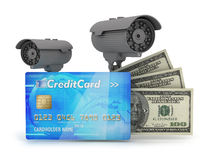 Two surveillance cameras, credit card and dollar bills Stock Photography