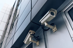 Two surveillance cameras on modern building Royalty Free Stock Photo
