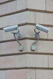 Two surveillance cameras on the wall Stock Images