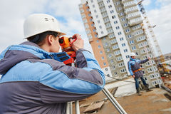 Two surveyors worker with theodolite Stock Images