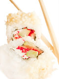 Two sushi roll with chopsticks over white Stock Photo