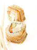 Two sushi roll with omelette and eel Stock Images