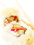 Two sushi roll with salmon and chopsticks Royalty Free Stock Photos