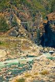 Two suspension bridges over Dhudh Kosi river. Two suspension bridges over beautiful Dhudh Kosi river not far from Namche Bazaar. Solukhumbu, Sagarmatha National Stock Images