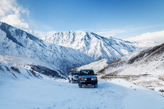 Two suv riding in snowy mountains Royalty Free Stock Image