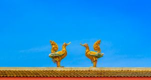 Two swan statues face-to-face Royalty Free Stock Images
