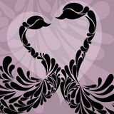 Two swans decorated with floral. Royalty Free Stock Photos