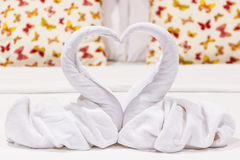 Two swans heart shaped made from towels. Stock Images
