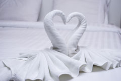 Two Swans Made Of Towels Forming Look Like Heart Shape On Bed Stock Photo