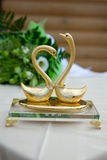 Two swans with wedding ringss Royalty Free Stock Image