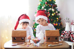 Two sweet boys, brothers, making gingerbread cookies house Royalty Free Stock Photo