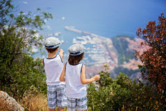 Two sweet boys, children watching the view of Monaco from top of. Hills on a sunny day summertime stock image
