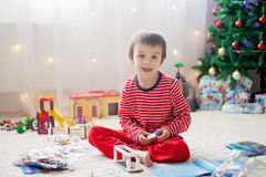 Two sweet boys, opening presents on Christmas day Royalty Free Stock Images