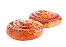 Two sweet buns with cinnamon Stock Photos