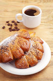 Two sweet buns and coffee Royalty Free Stock Images