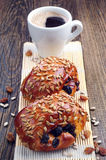 Two sweet buns and cup of coffee Stock Image